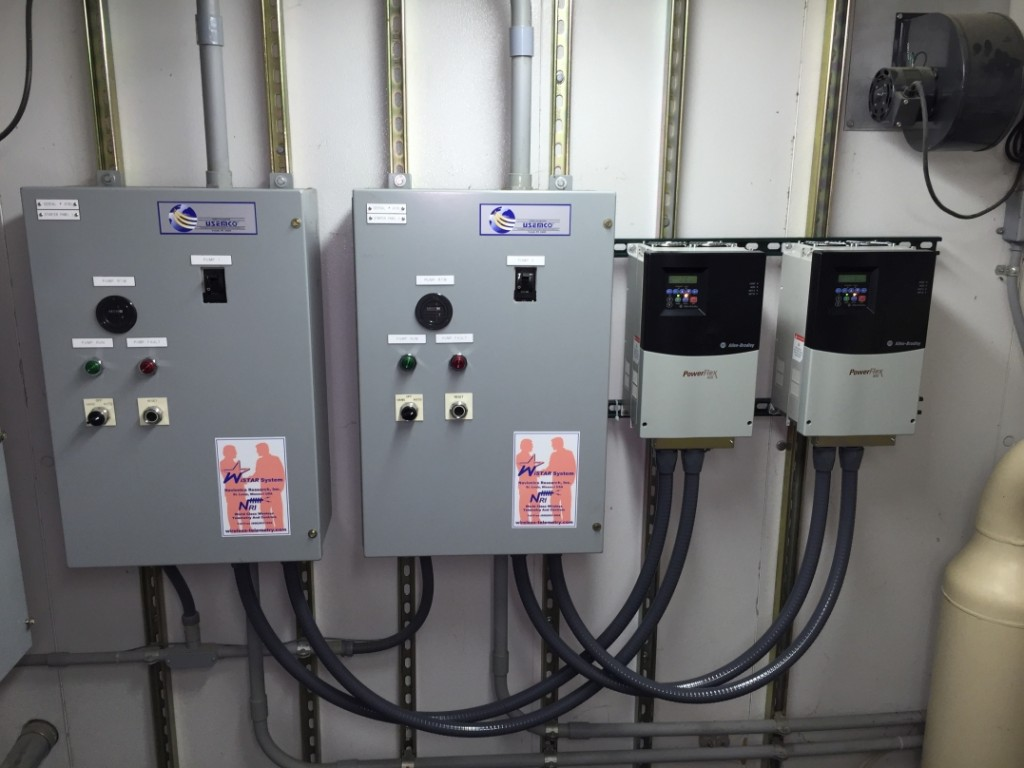 Pump Circuit Breaker / Load Reactor Panels (Left). New PowerFlex 400 Variable Frequency Drives (Right).