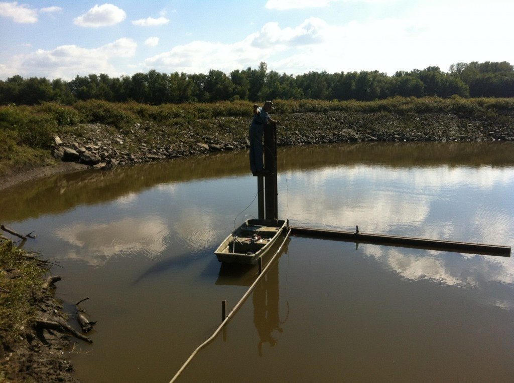 Installation of the River-Side Tubing. Hank Borrenpohl, Okawville Electric.